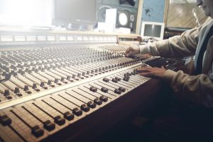 Man mixing at recording console